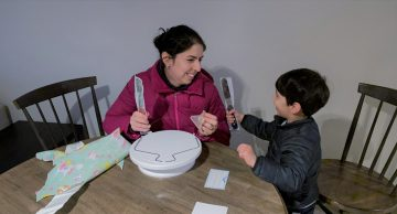 Narges Hadjesfandiari and her son open up their prizes from the CBR Frosted February Baking Contest, which includes spatulas, a custom-printed cookie cutter, and more.