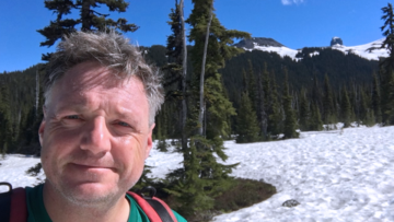 Dr. Schubert hiking on the snowy slopes in Garibaldi Provincial Park