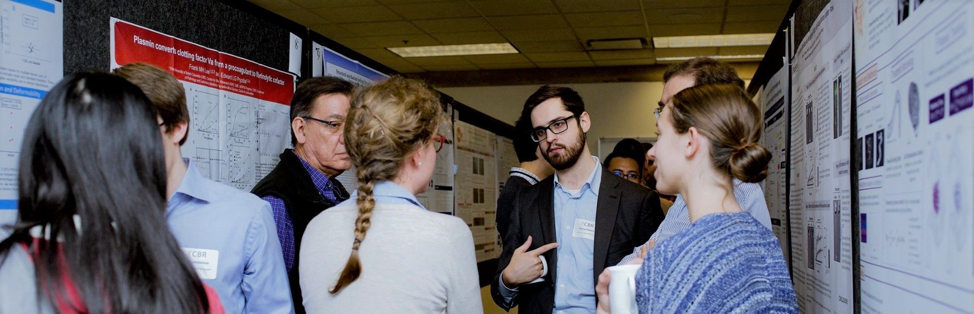 Scientists presenting their posters and chatting with attendees at the 2019 Norman Bethune Symposium