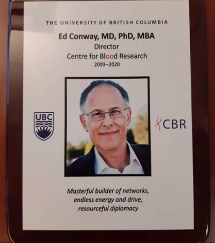 Plaque with Dr. Ed Conway's bio photo, the UBC logo, and CBR logo. The plaque notes that Dr. Ed Conway, PhD, MD, MBA was the Director of the Centre for Blood Research from 2009 - 2020, and highlights some of his key qualities as Director: a masterful builder of networks, his endless energy and drive, and his resourceful diplomacy.
